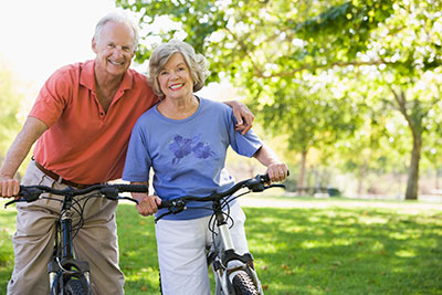 Elderly couple bicycling